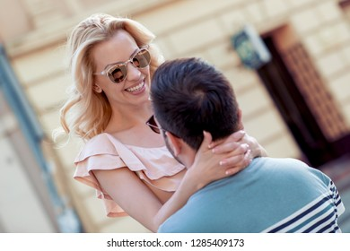 Portrait of beautiful young couple outside. Couple in love outdoor.
