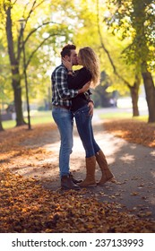 portrait of beautiful young couple in a park kissing