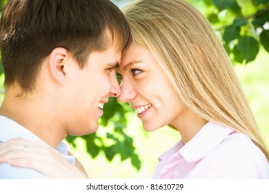 Portrait of beautiful young couple in park