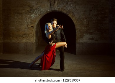 Portrait of a beautiful young couple. They dance tango.
