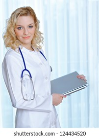 Portrait of a beautiful young doctor with laptop computer