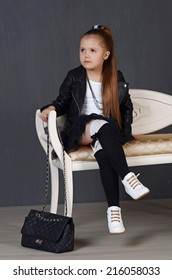 Portrait of a beautiful young female child model wearing a black