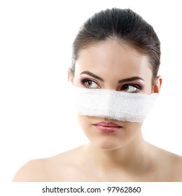 portrait of beautiful young female face with bandage on her nose - beauty treatment plastic surgery