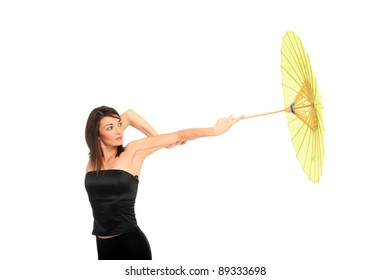 Portrait of beautiful young female with umbrella on white background