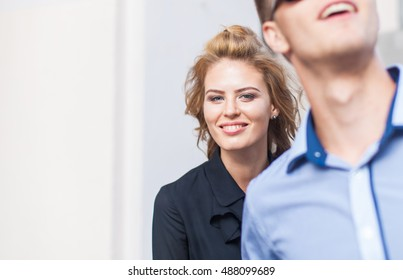 portrait of a beautiful young girl blonde looking out for a young man