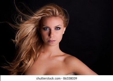 Portrait of a beautiful young girl with blowing hair