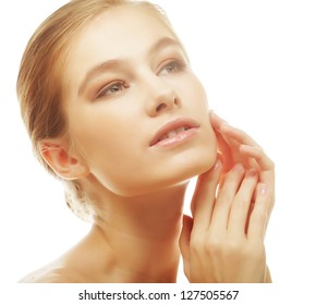 Portrait of beautiful young girl with clean skin on pretty face - white background