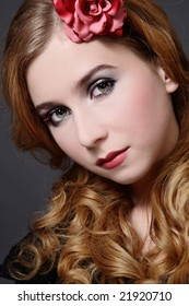 Portrait of beautiful young girl with curling blond hair