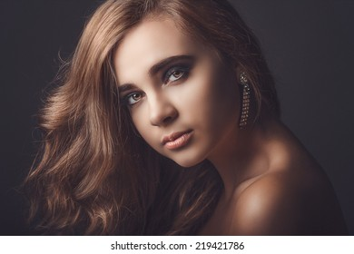Portrait of beautiful young girl. Fashion photo