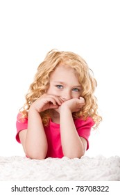 Portrait of a beautiful young girl with goldilocks curly hair and blue eyes thinking expression, isolated.
