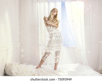 Portrait of beautiful young girl in the interior of the window