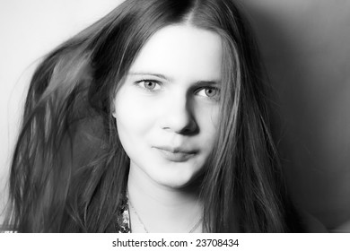 Portrait of the beautiful young girl with long hair