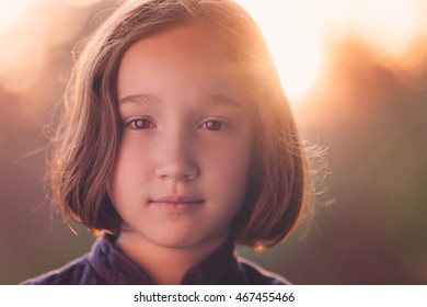 Portrait of a beautiful young girl looking at the camera.
