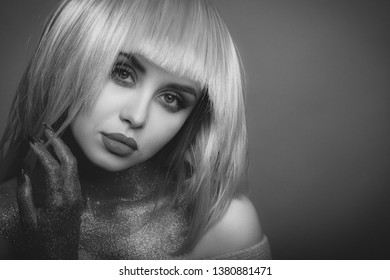 Portrait of a beautiful young girl. Makeup in the style of beauty. Bright lips and eyes. Journal detailed skin retouching. Expressive eyebrows. Huge eyelashes. Grey shades.