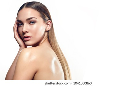 Portrait of a beautiful young girl with natural make-up and well-groomed hair on a white background in the studio.Fashion, beauty, natural appearance, spa, nude, beauty salon, natural cosmetics.