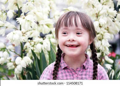Portrait of beautiful young girl on flowers background.