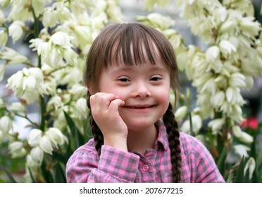 Portrait of beautiful young girl on flowers background