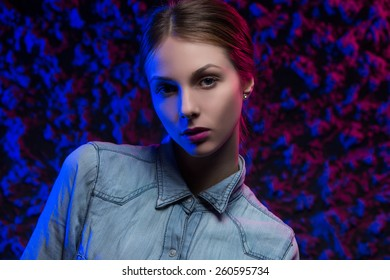 portrait of a beautiful young girl on a bright background