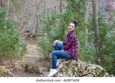 Portrait of a beautiful young girl on nature