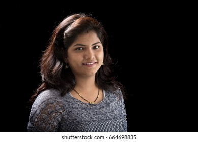Portrait of beautiful young girl on black background