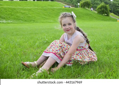Portrait of a beautiful young girl outdoors in the garden