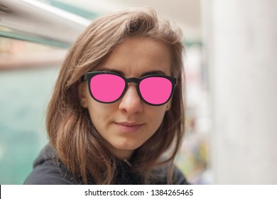 Portrait of the beautiful young girl in sunglases