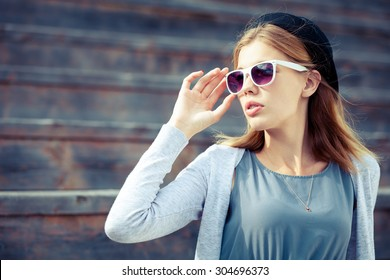 portrait of a beautiful young girl  in sunglasses outdoors at the day time
