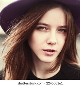 portrait of a beautiful young girl wearing a hat close up