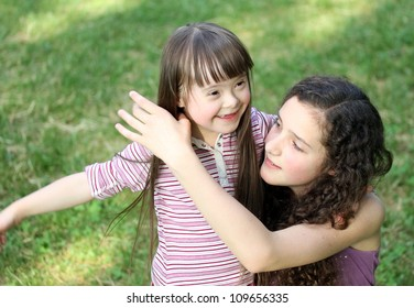 Portrait of beautiful young girls in the park