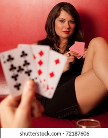 Portrait of beautiful young girls play poker