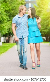 Portrait of a beautiful young happy smiling couple - walking at green park outdoor