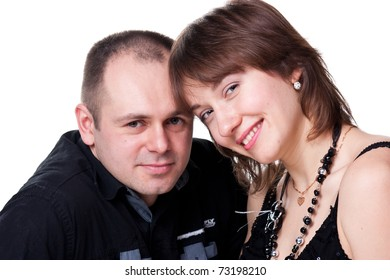 Portrait of a beautiful young happy smiling couple isolated on white
