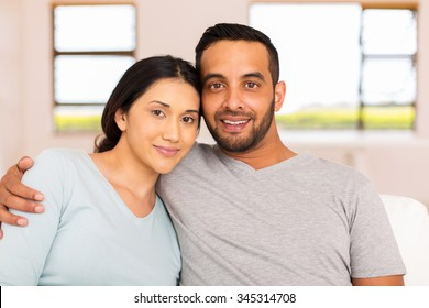 portrait of beautiful young indian couple relaxing at home
