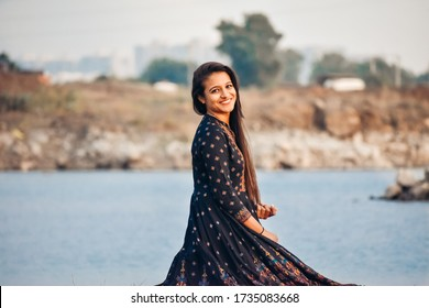 Portrait of a beautiful young Indian female model wearing Kurti staring at the camera