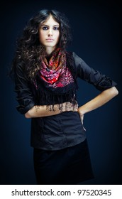 Portrait of a beautiful young lady with long curly hair