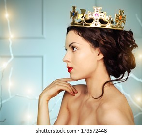 Portrait of a beautiful young model in the crown