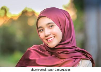 Portrait of beautiful young model  in fashionable hijab style posing in beautiful sunset . Stylish Muslim female hijab fashion lifestyle portraiture concept.