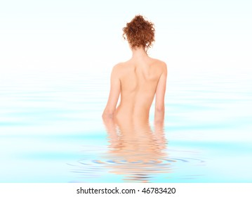 Portrait beautiful young nude woman in the water
