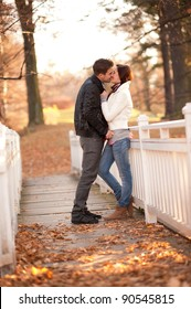 portrait of beautiful young pair in a park kissing