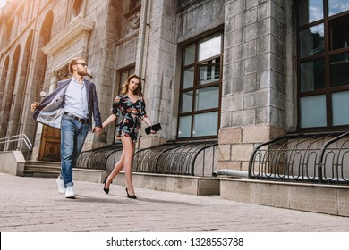 Portrait of a beautiful young people walking in the city. Summer fashion.