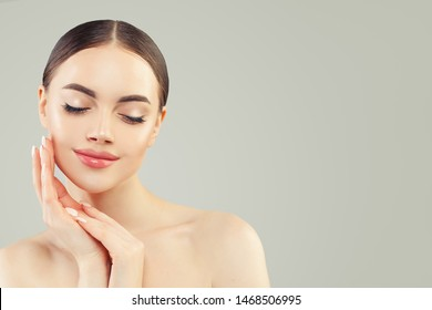 Portrait of Beautiful young perfect woman with clear skin. Skincare and facial treatment