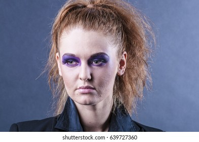 Portrait of a beautiful young red curly girl with bright make-up