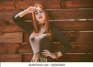 Portrait of beautiful young redhead hippie woman standing near nature. Freedom lifestyle