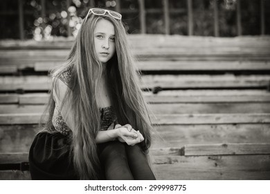 portrait of a beautiful young sad hipster girl  outdoors at the day time