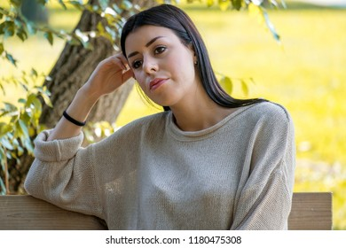 Portrait of beautiful young sad woman outdoors feeling seasonal affective disorder syndrome