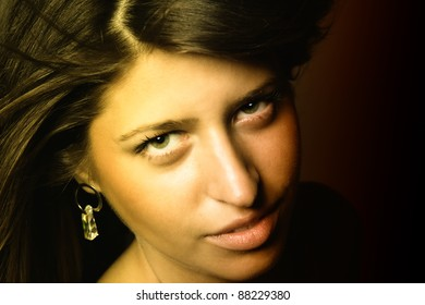 Portrait of a beautiful young sexy woman over dark background