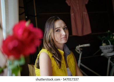 Portrait of beautiful young smiling woman at restaurant