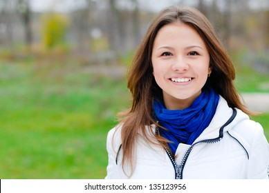 portrait of beautiful young teen brunette girl happy smiling with hands crossed