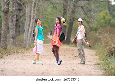 Portrait of Beautiful young traveler woman walking in forest (Phukradung), thailand