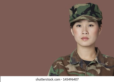Portrait of beautiful young US Marine Corps soldier over brown background